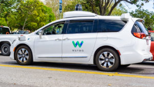 Waymo self driving car performing tests on a street near Google's headquarters, Silicon Valley