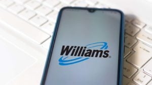 The Williams Companies (WMB) logo displayed on a smartphone.