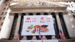 A banner for Yum China (YUMC) decorates the New York Stock Exchange.