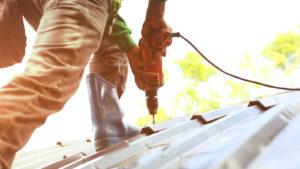Technician working on roof repair