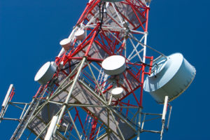tall communications tower representing communications stocks