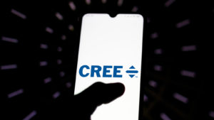 Cree (CREE) logo shining brightly on a smartphone screen in a dark room