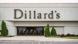 Dillard's (DDS) storefront with trees and shrubs around entrance
