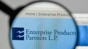 A magnifying glass zooms in on the website of Enterprise Product Partners (EPD)