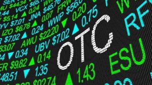 "A ticker tape reads ""OTC"" in big letters. otc stocks"