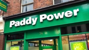 The front of a Paddy Power shop from Flutter Entertainment (PDYPY) in Derby, United Kingdom.
