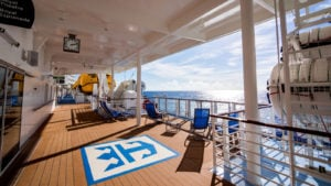 Deck of a Royal Caribbean (RCL) cruise ship looking over the ocean