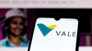 the Vale (VALE) logo displayed on a mobile phone with the company's webpage in the background