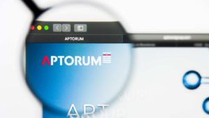 A magnifying glass zooms in on the website for Aptorum Group (APM).