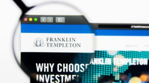 A magnifying glass zooms in on the website for Franklin Resources (BEN).