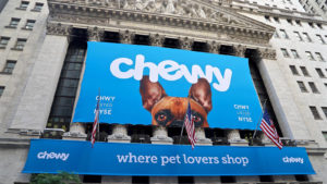 The Chewy (CHWY) logo on a banner at the New York Stock Exchange.
