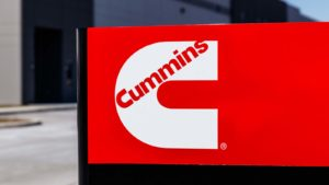A Cummins (CMI) sign in bright red.