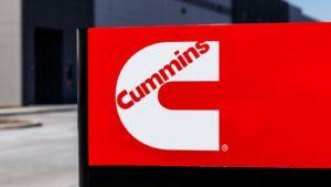 A Cummins (CMI) sign in bright red.