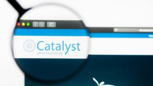 A magnifying glass zooms in on the website of Catalyst Pharmaceuticals (CPRX).