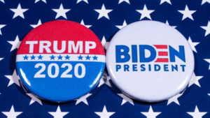 Election buttons for Donald Trump and Joe Biden side by side on a blue background with white stars.