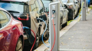 electric vehicles charging at a charging station. electric vehicle stocks