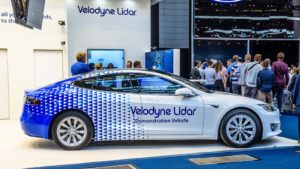 A Velodyne Lidar (GRAF) demonstration car parked at a display.