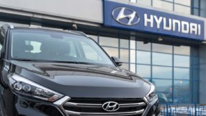 A close-up shot of a Hyundai (HYMTF) vehicle outside of a dealership in Russia.