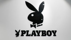The Playboy Enterprises logo on a white wall