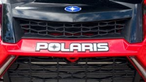 A close-up shot of a Polaris (PII) all terrain vehicle.