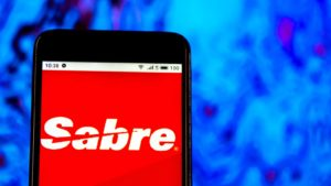 The logo for Sabre Corporation (SABR) is displayed on a smartphone screen.