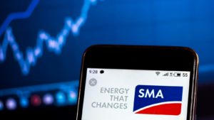 The logo for SMA Solar Technology (SMTGF) is displayed on a smartphone screen.