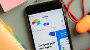 The app download screen for Airtable is displayed on a smartphone.
