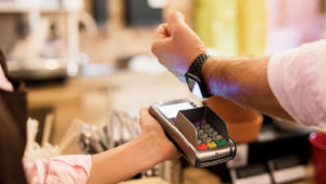 Image of a person checking out using Apple Pay.