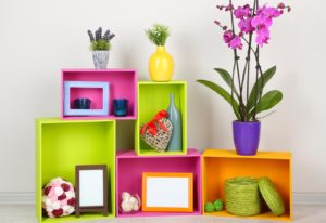 Beautiful colorful shelves with different home related objects.