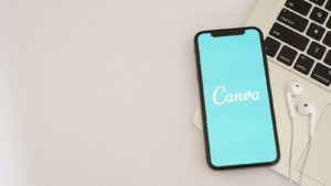 The logo for the Canva app is displayed on a smartphone screen.
