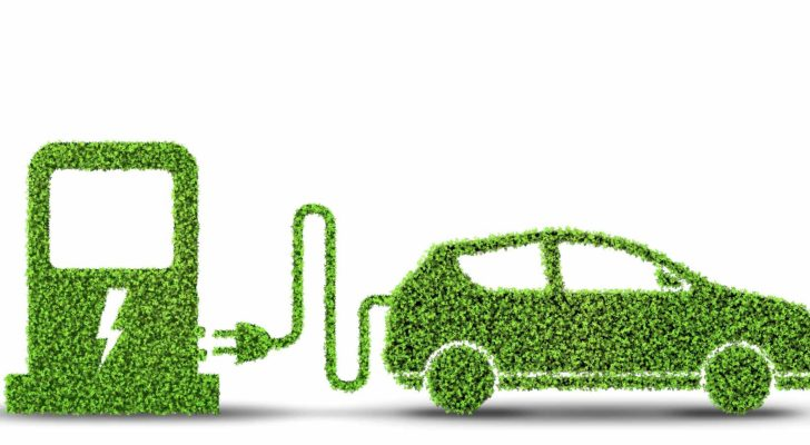 Electric car concept in green environment.