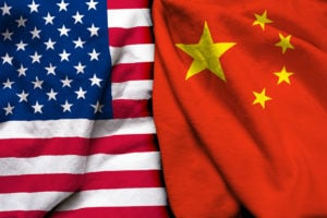 side-by-side shot of American flag and flag of China