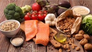 healthy food uncluding salmon, broccoli, tomatoes, nuts and more