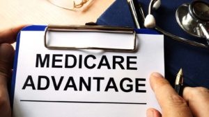 "A close-up of a clipboard that is labeled ""Medicare Advantage."""