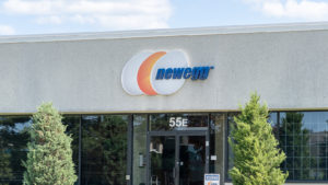 Image of the Newegg logo on the front of a building.