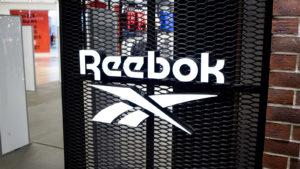 Image of the Reebok logo on a metal mesh door.