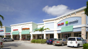 image of a strip mall with several business.