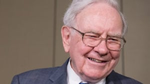 a picture of warren buffett smiling. warren buffett stocks