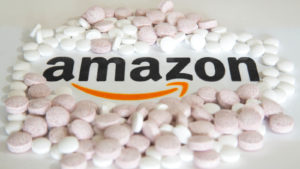 an image of pills surrounding the Amazon logo