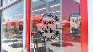 Bilgari Holdings (BH) restaurant Steak N Shake's logo on the front window of a restaurant in Riverside, California.