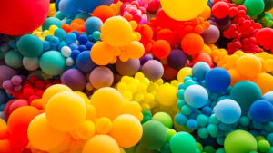 Image of brightly colored balloons together.