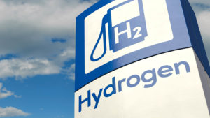 An image of a hydrogen fueling station against a blue sky.
