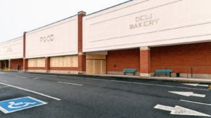 Large supermarket in a shopping center abandoned and boarded up