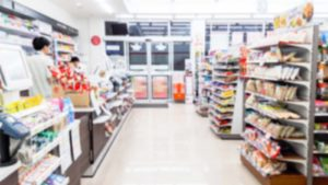 A blurred image of the inside of a convenience store.