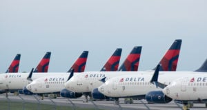 Delta Airplanes sit in a row at Kansas City International Airport