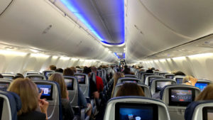 Delta airlines aircraft interior full of passengers