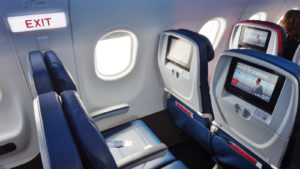 Inside the airplane cabin of a Delta flight.