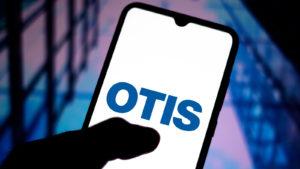 momentum stocks: a smartphone screen displaying the Otis Worldwide (OTIS) logo