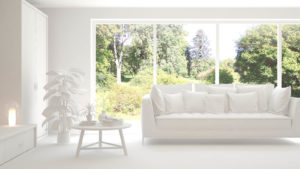 An Illustration of a living room with large windows and an all-white interior.