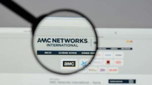 A magnifying glass zooms in on the website for AMC Networks (AMCX).